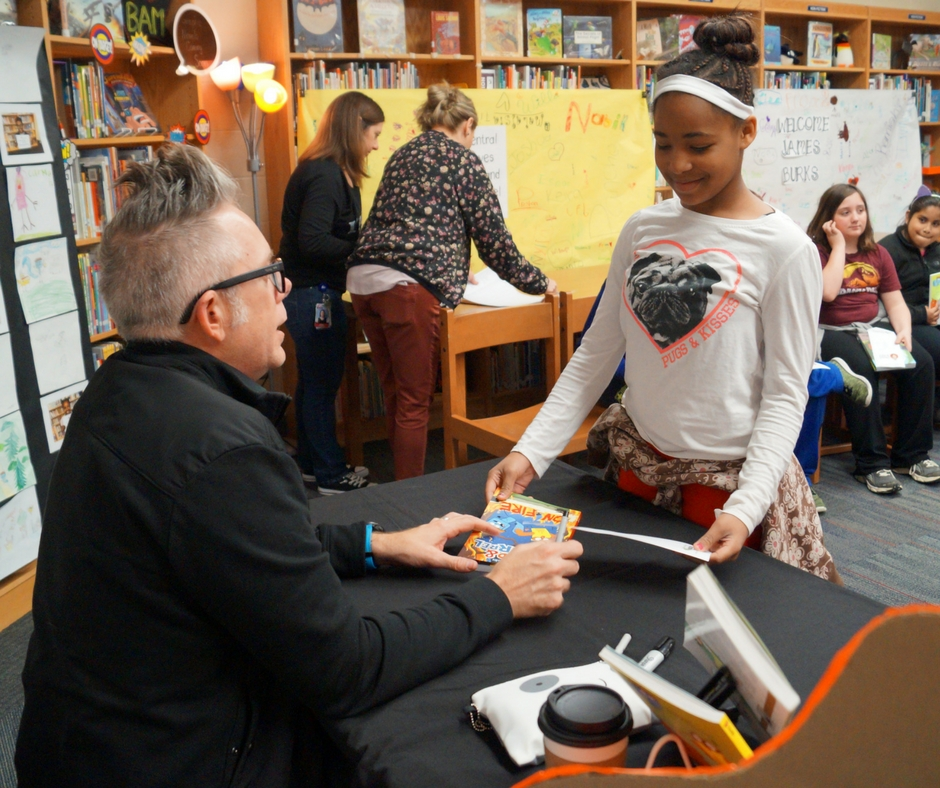 Student visiting with author